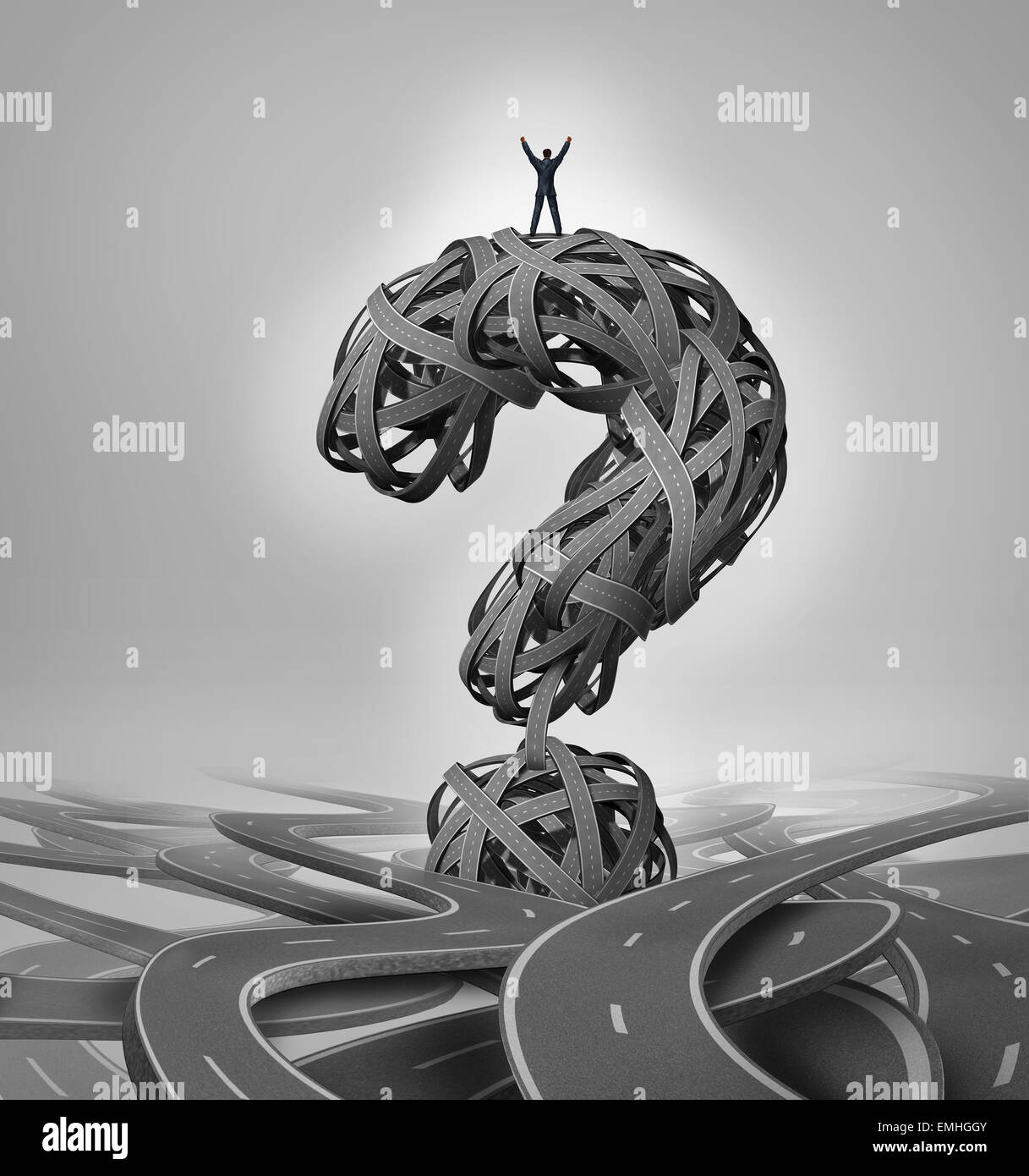 Solution road business concept as a businessman standing with arms raised in victory on a group of roads shaped - Stock Image