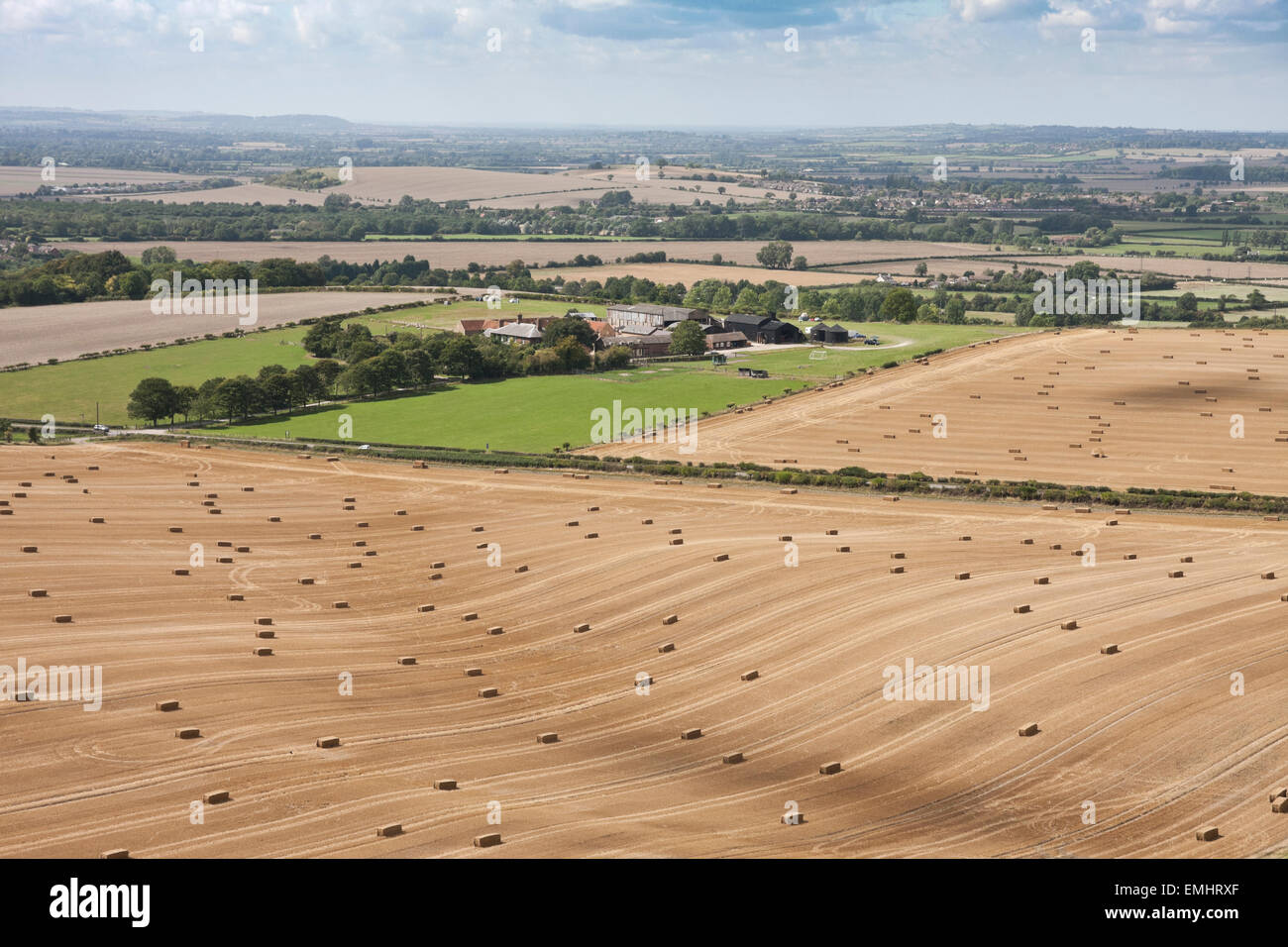 Elevated landscape shot of Hay bales in a wheat field in the Chiltern hills, UK - Stock Image