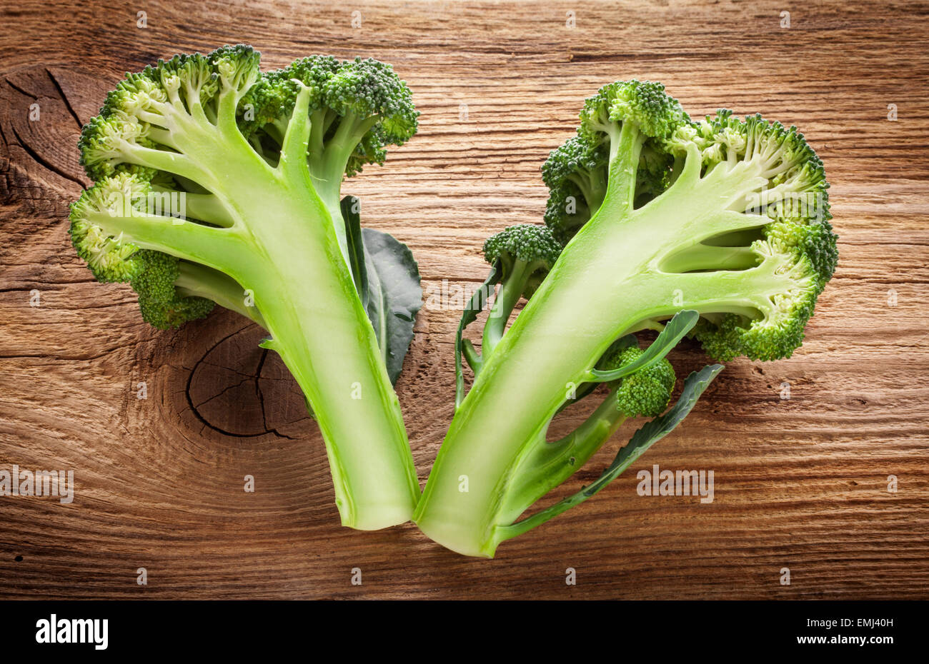 Fresh broccoli on the wooden table - Stock Image
