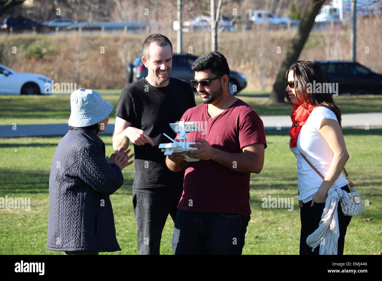Conversing about a drone. - Stock Image