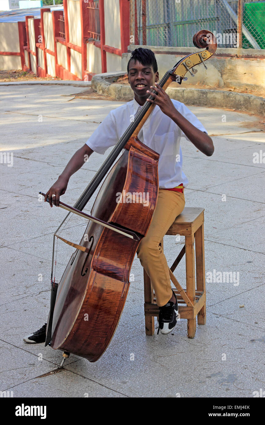 Music Student Boy bass player Benny More School of the Arts Cienfuegos Cuba - Stock Image