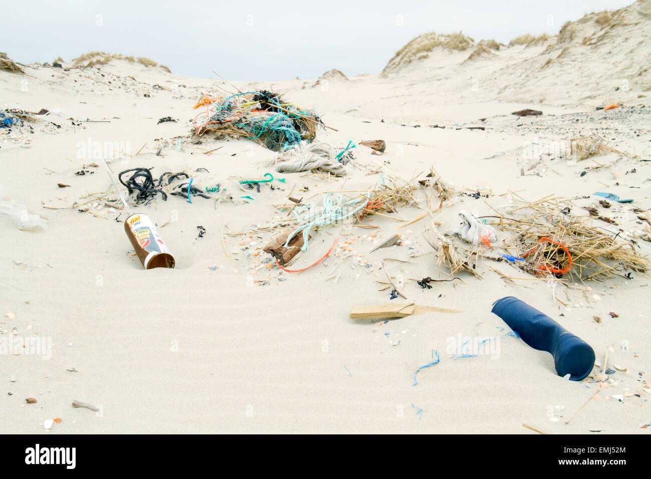 Plastic waste washed ashore on a beach - Stock Image