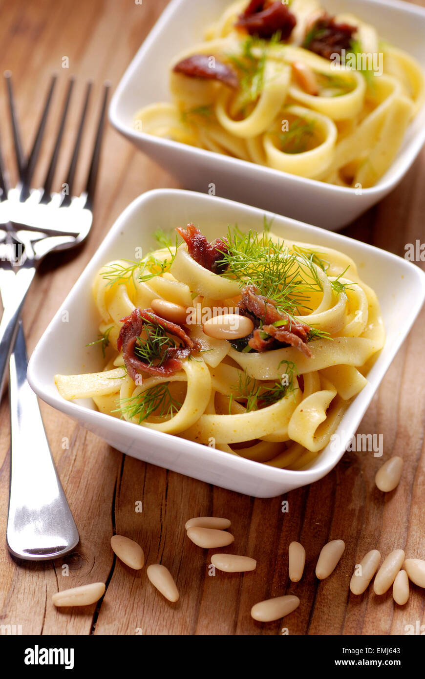 noodles with anchovies, pine nuts and fennel in white bowl - Stock Image