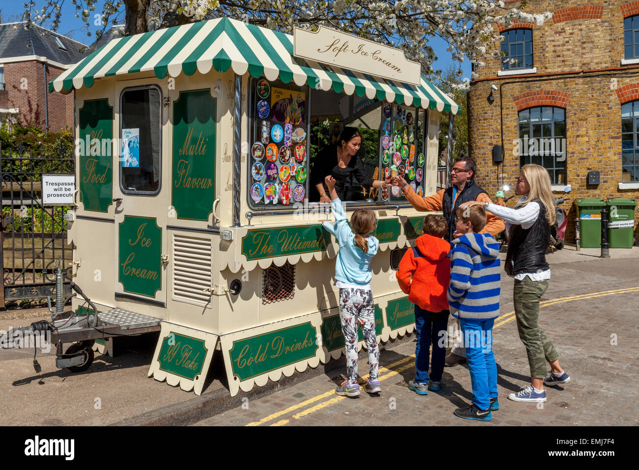 A Family Buying Ice Creams From a Traditional Ice Cream Van, Richmond Upon Thames, London, England - Stock Image