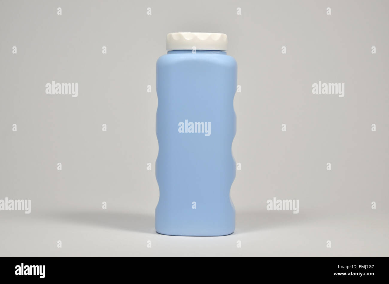Blue plastic container for talc with white lid - Stock Image