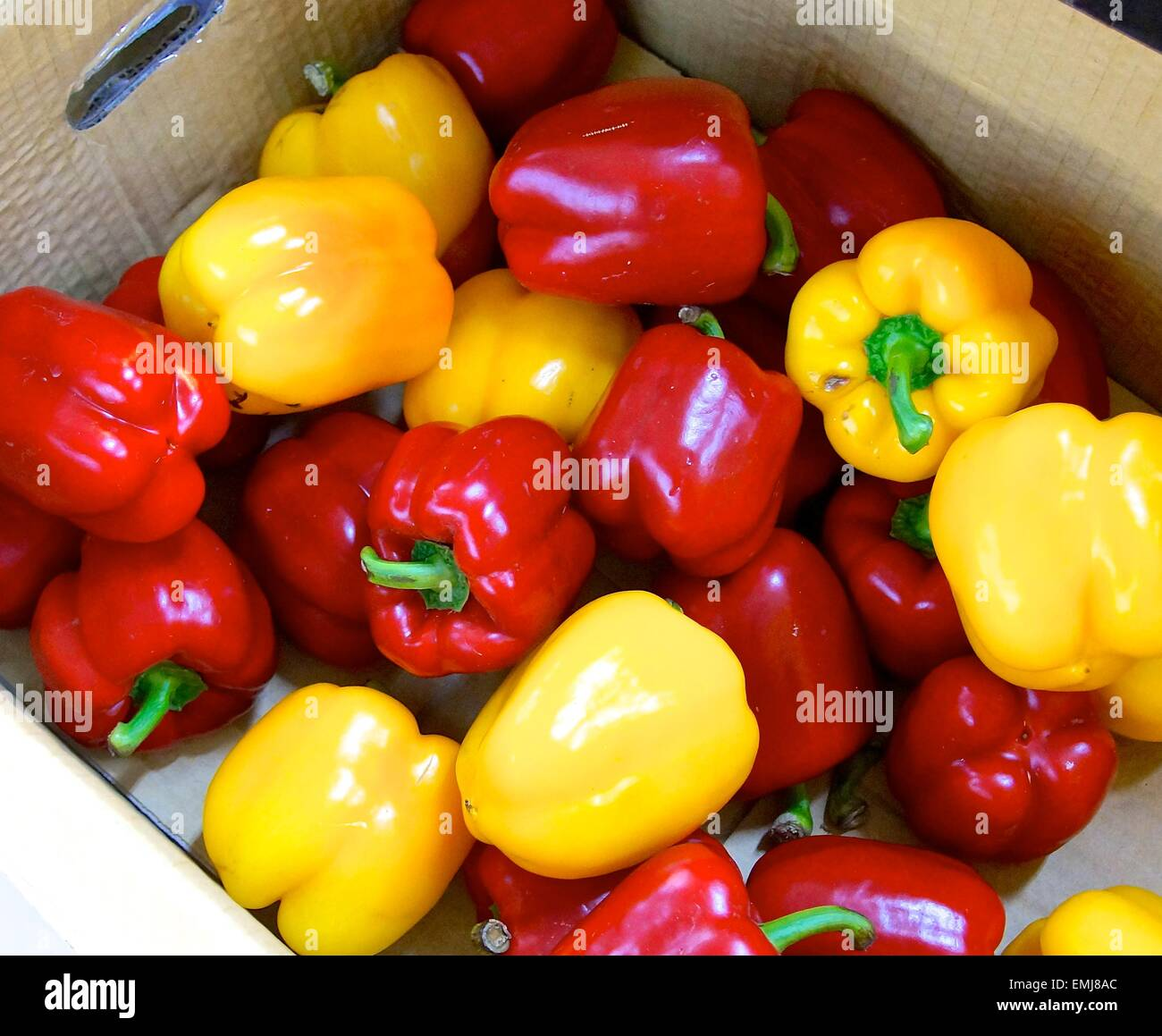 Red,yellow pepper in the box for sale - Stock Image