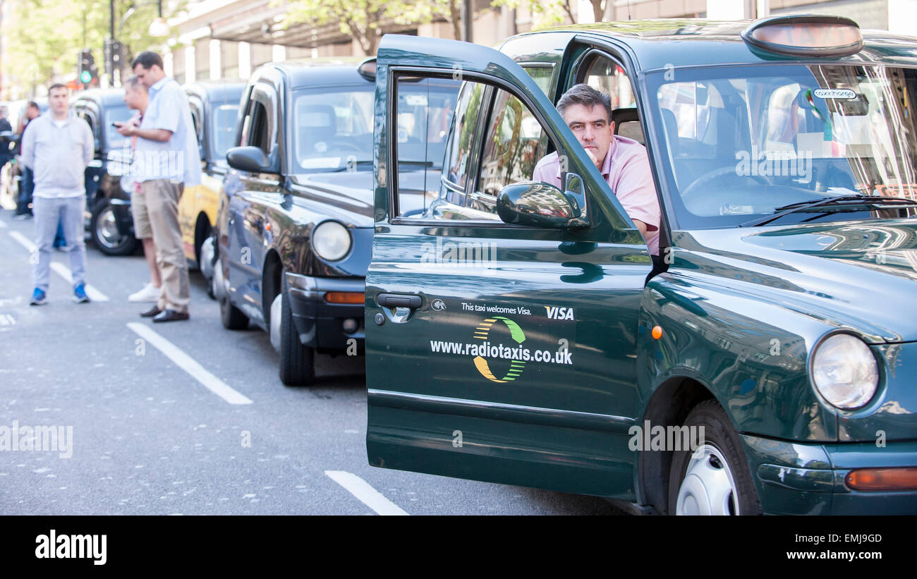 Oxford Street, London, UK. 21 April 2015.  London black cab taxi drivers, members of the United Cabbies Group, take Stock Photo