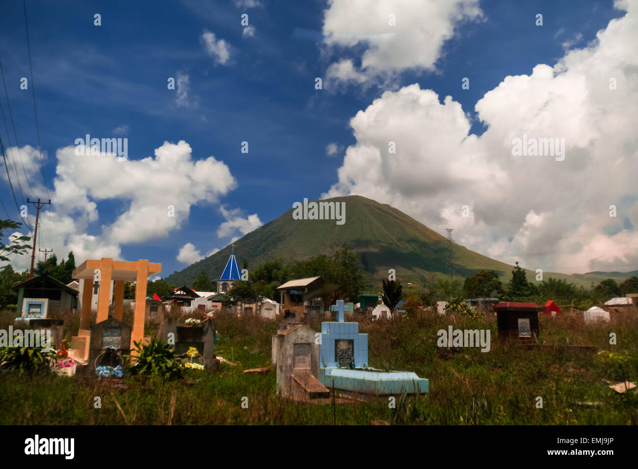 Graveyard below Mount Lokon, North Sulawesi, Indonesia. - Stock Image