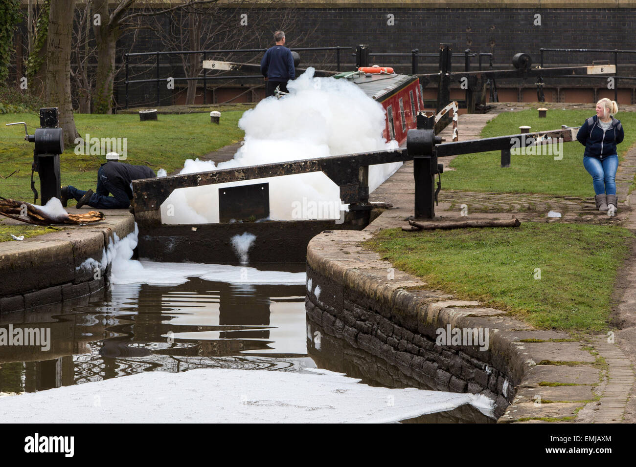Manchester Ashton canal - a wall of foam appears on the canal after a fire at a nearby chemical plant - Stock Image