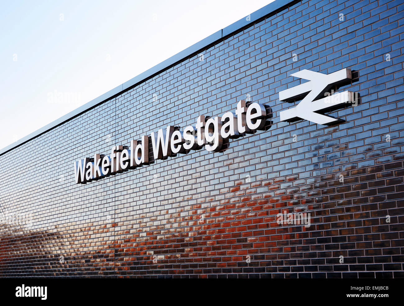Large sign on exterior wall of Wakefield Westgate railway station. Copy space for text - Stock Image