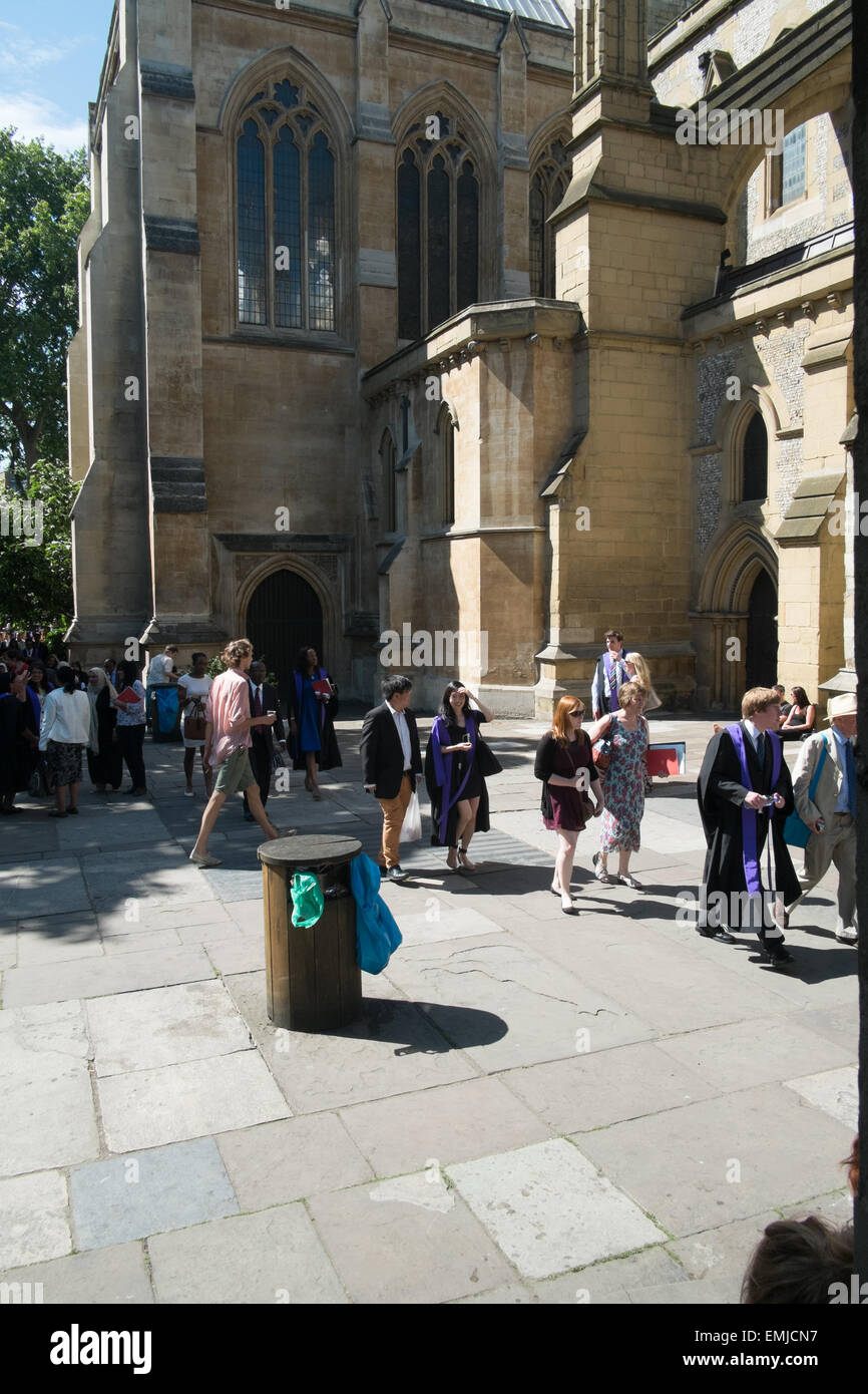 Guests of a wedding outside of a cathedral. - Stock Image