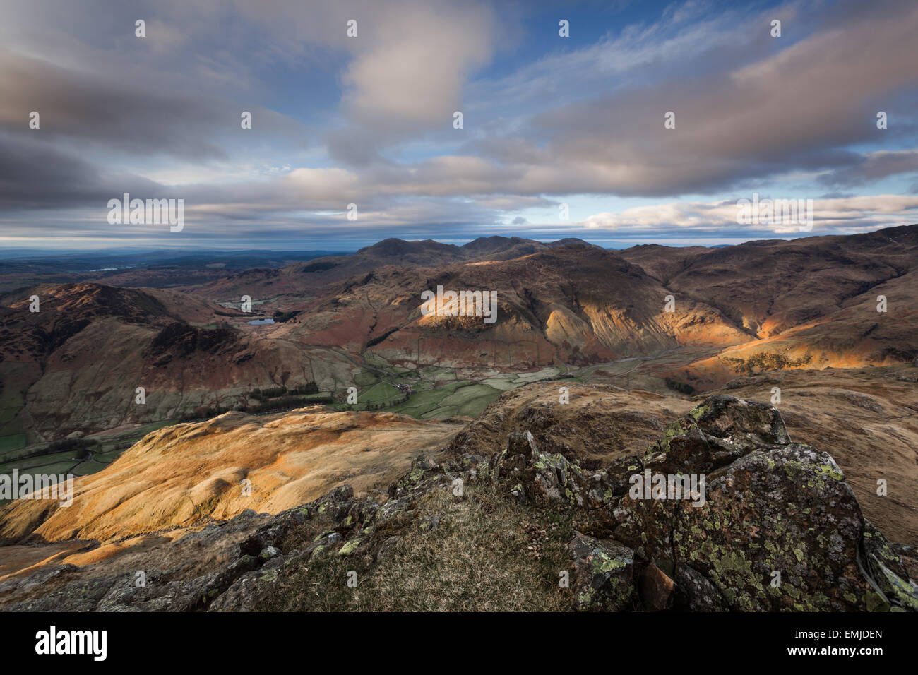 The first light of dawn sunrise catching the fells of Great Langdale in the English Lake District - Stock Image
