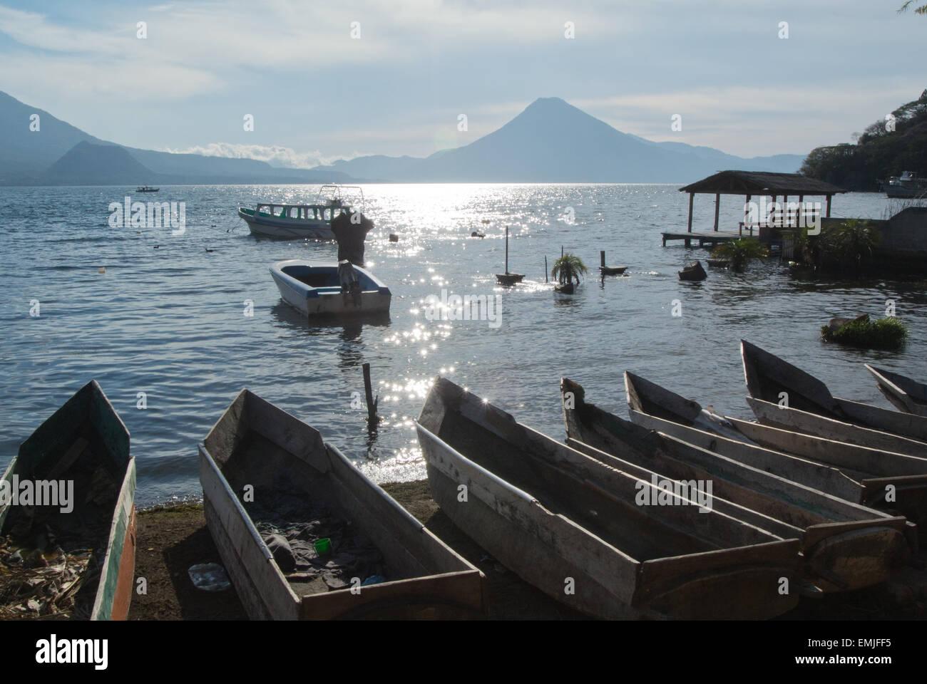 Mayan canoes at the edge of Lake Atitlan, Santa Catarina Palopo, Guatemala - Stock Image