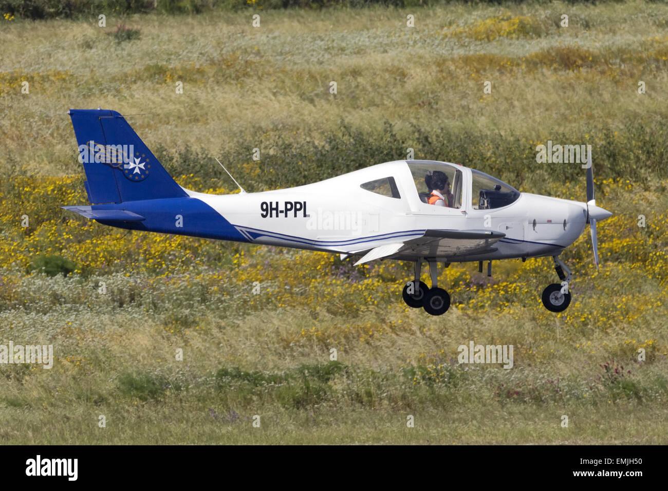 European Pilot Academy Tecnam P-2002JF Sierra, registration 9H-PPL, overflying the runway during a pilot training - Stock Image