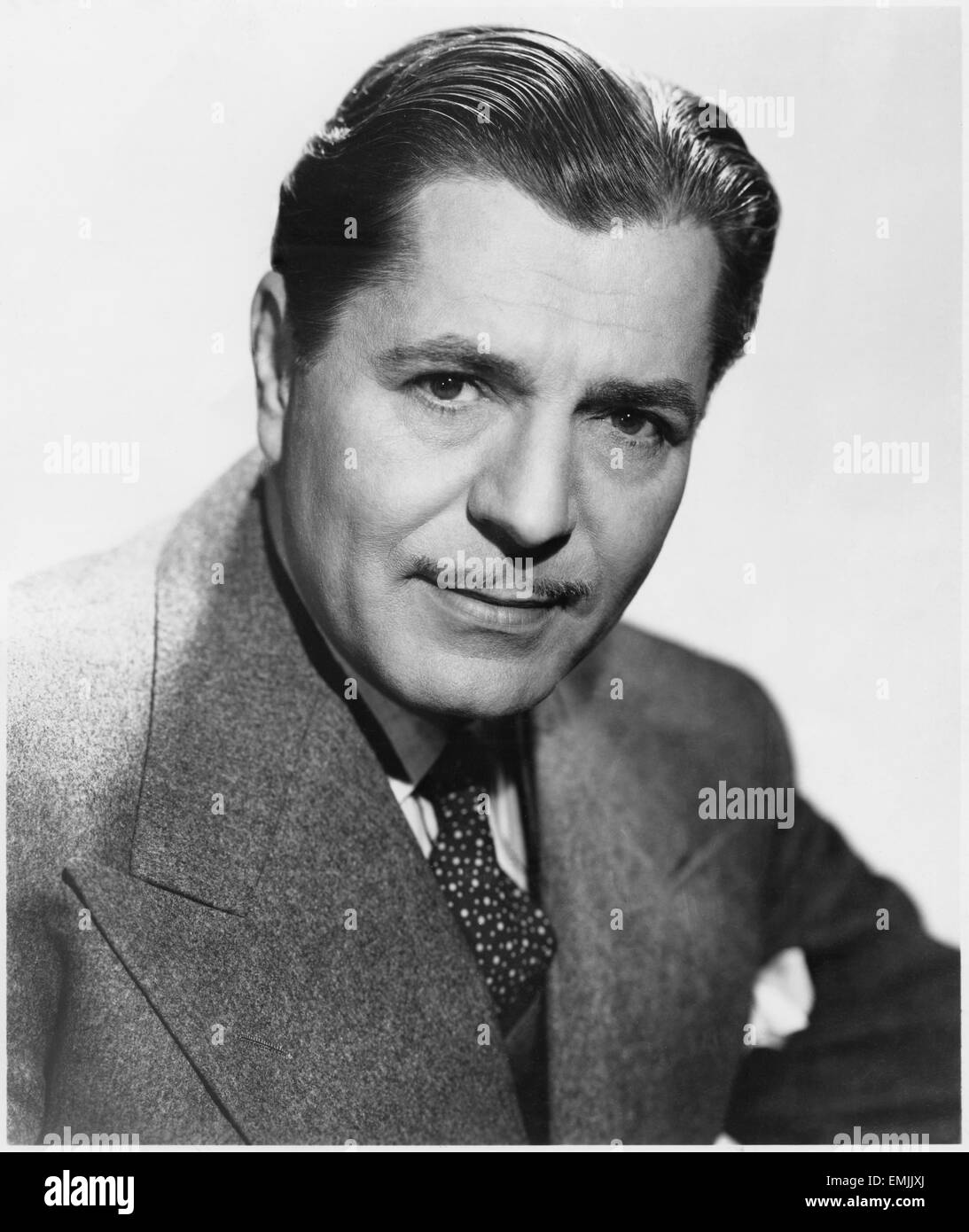Warner Baxter, Publicity Portrait for the Film 'Lady in the Dark', 1944 - Stock Image