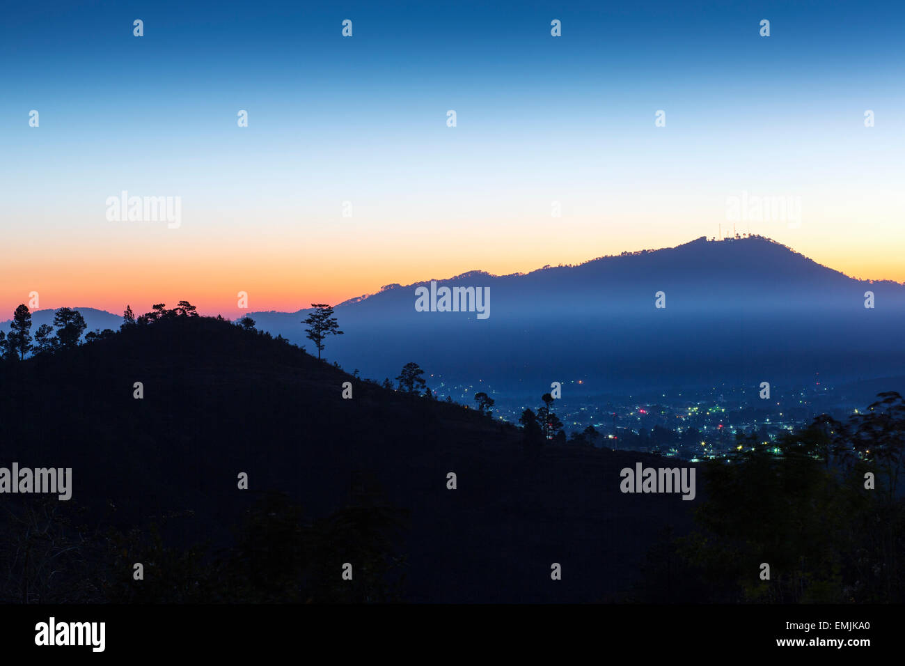Guatemala,Jalapa,dawn, mist in valley over the town of Jalapa - Stock Image