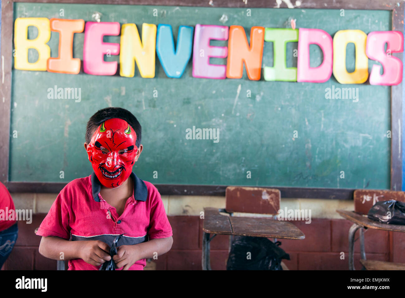 Guatemala,Jalapa, school boy wearing a devil mask. - Stock Image