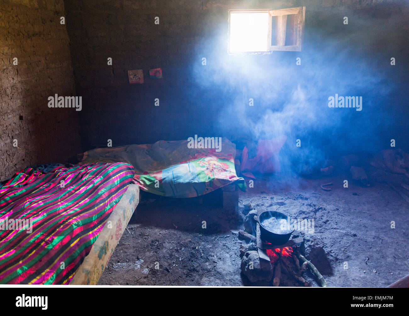 Guatemala,Jalapa,adobe home, smoky room with poor ventilation and fire pit for heating and cooking - Stock Image
