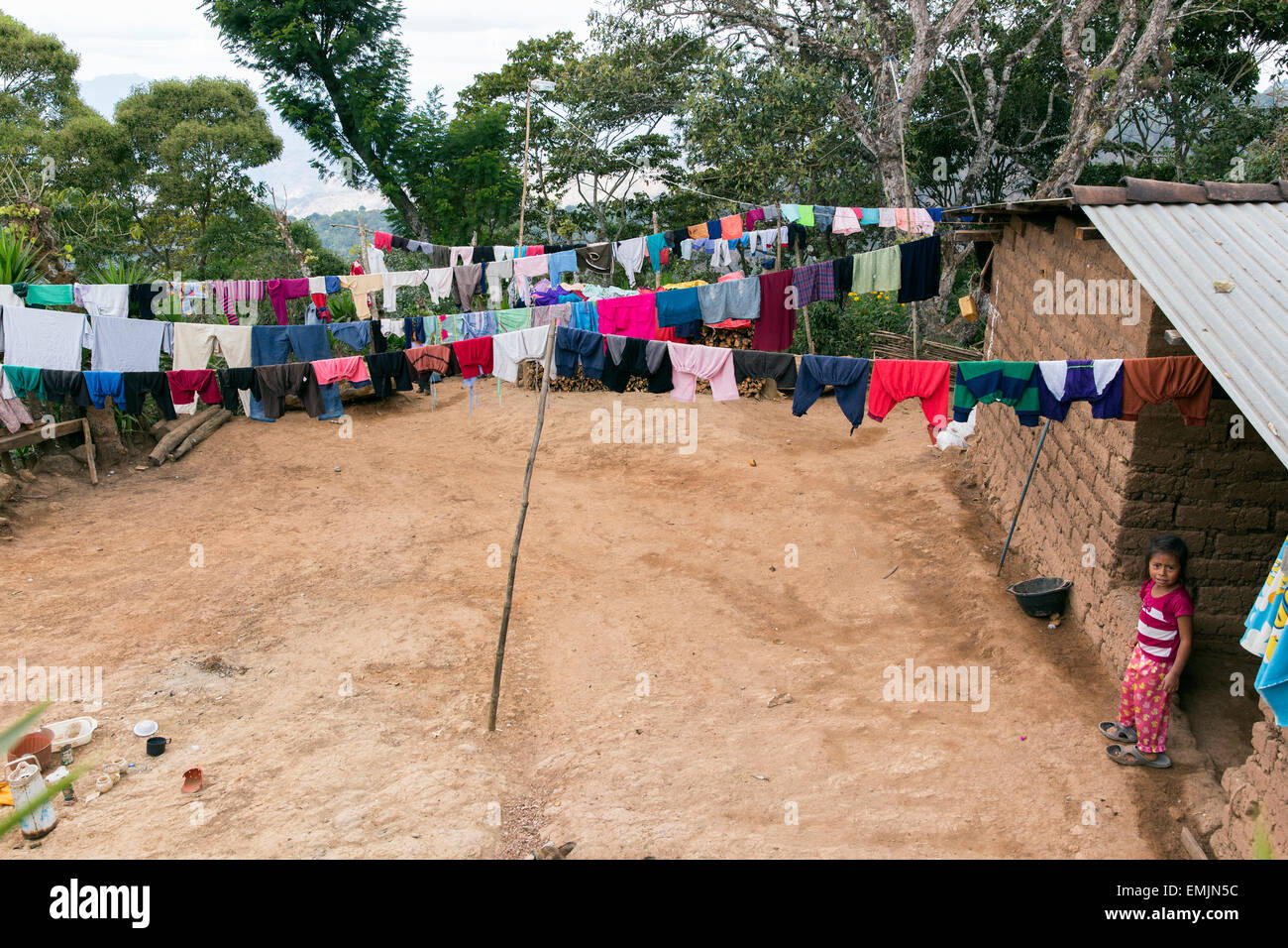 Guatemala,Jalapa, Palo Verde, adobe home with child and laundry. - Stock Image
