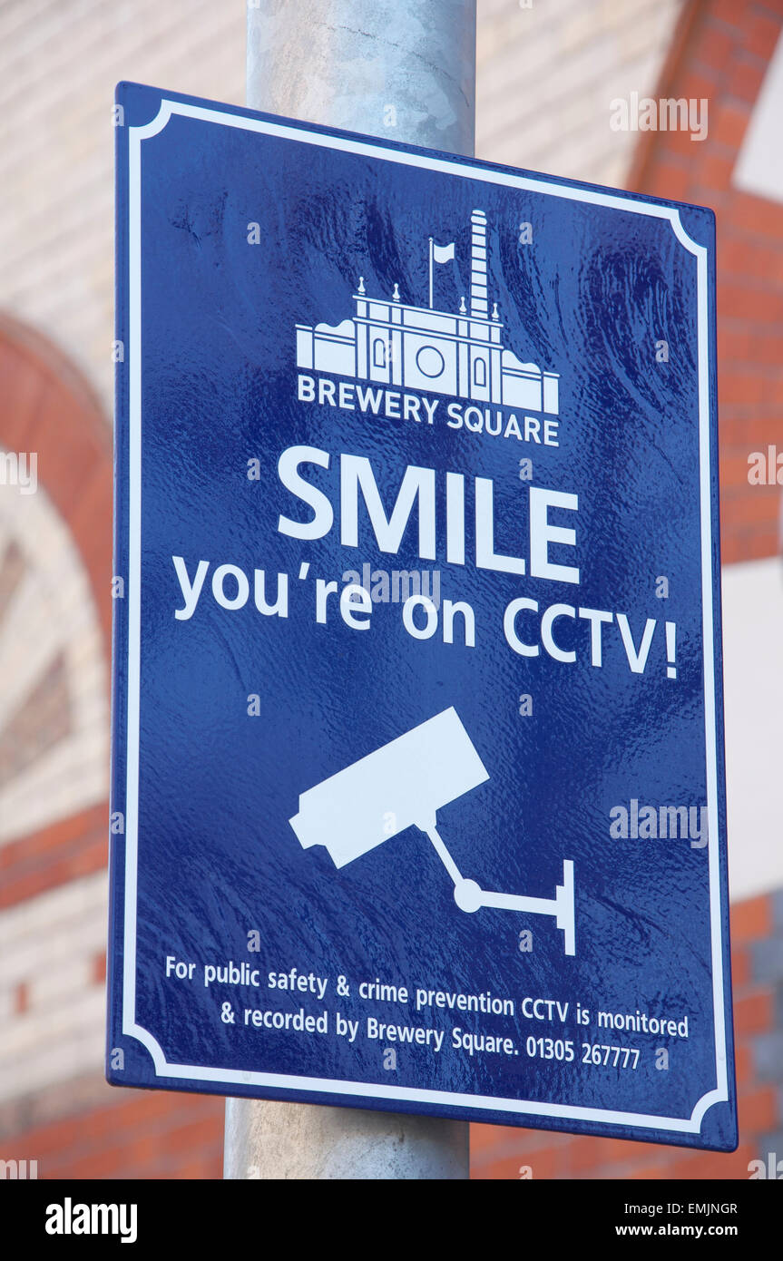 Quirky British humour. SMILE you're on CCTV. An amusing sign informs us we are under video surveillance, at - Stock Image