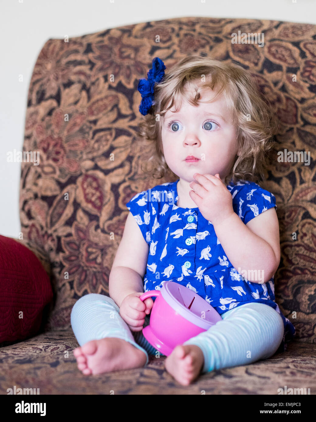 A Beautiful 14 Month Old Caucasian Girl Sits In A Chair