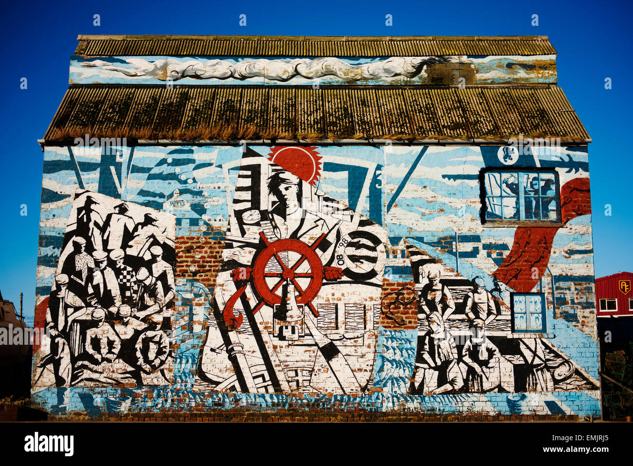 Mural reflecting Mallaig's seafaring history on a building in the port area. - Stock Image