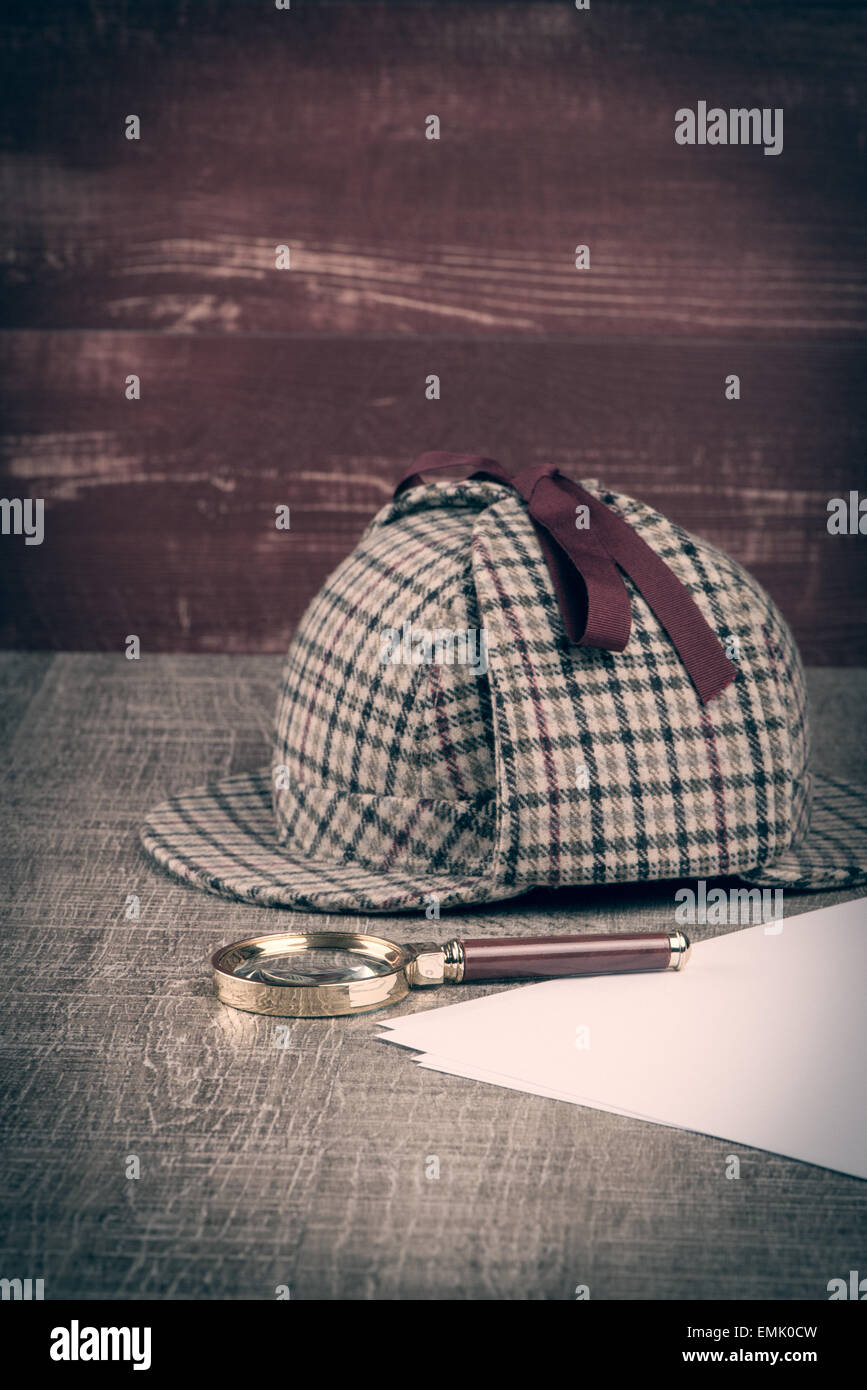 0d12b23f5 Deerstalker or Sherlock Hat and magnifying glass on Old Wooden table ...