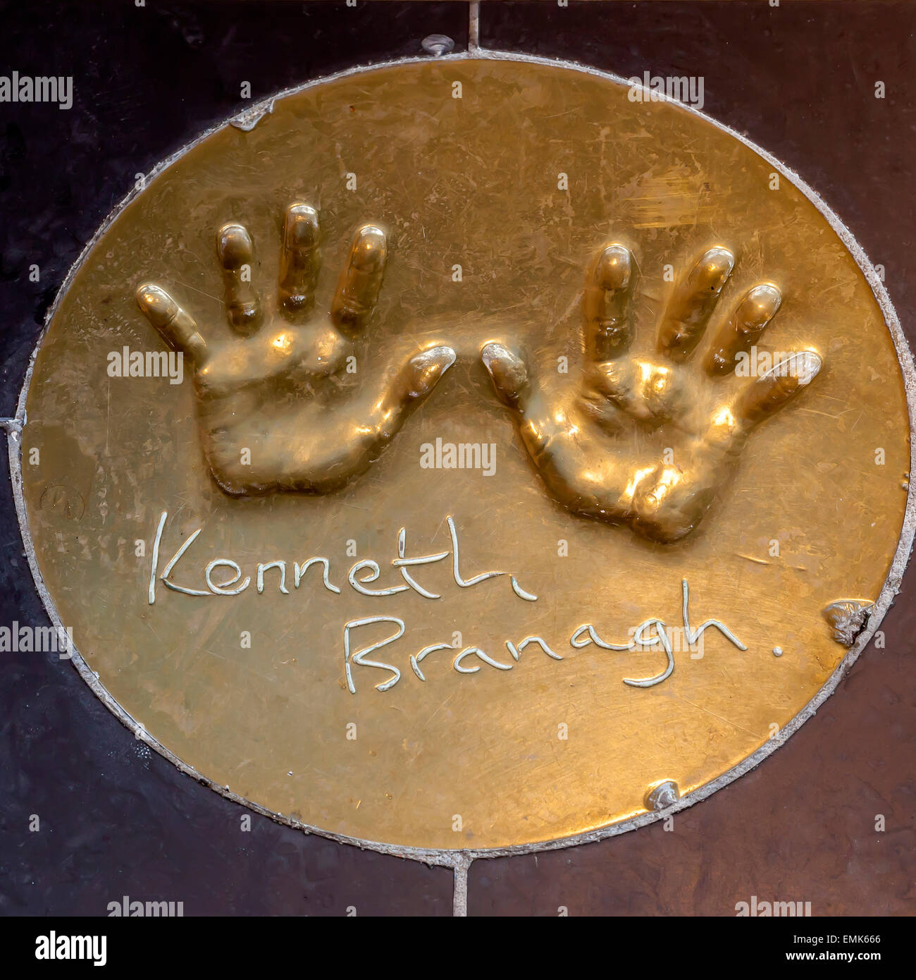 Handprints of British actor Kenneth Branagh on the floor in front of a London cinema, London, England, United Kingdom - Stock Image
