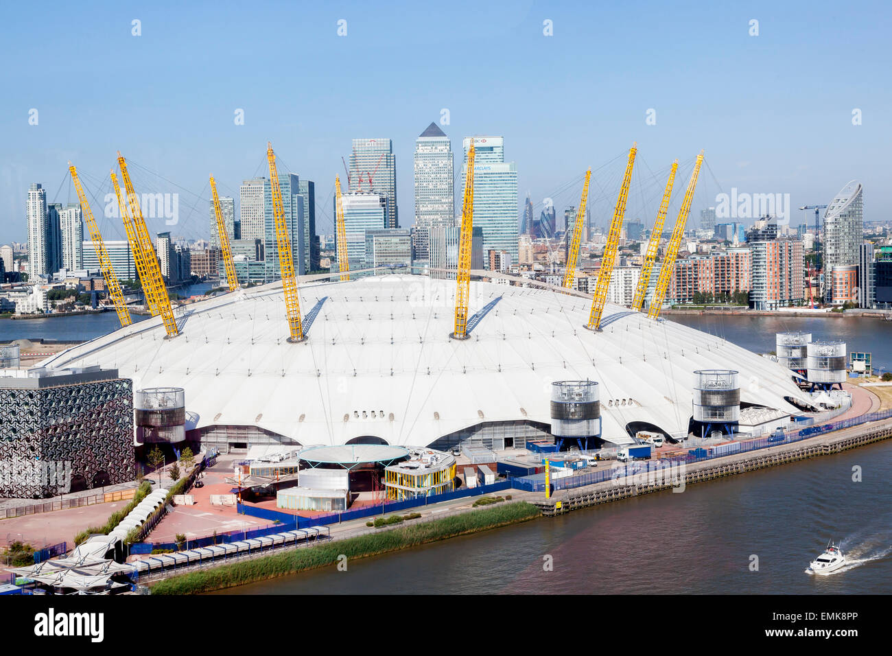 The Dome, Millennium Dome, The O2, with Canary Wharf financial district on the River Thames, London, England, United - Stock Image