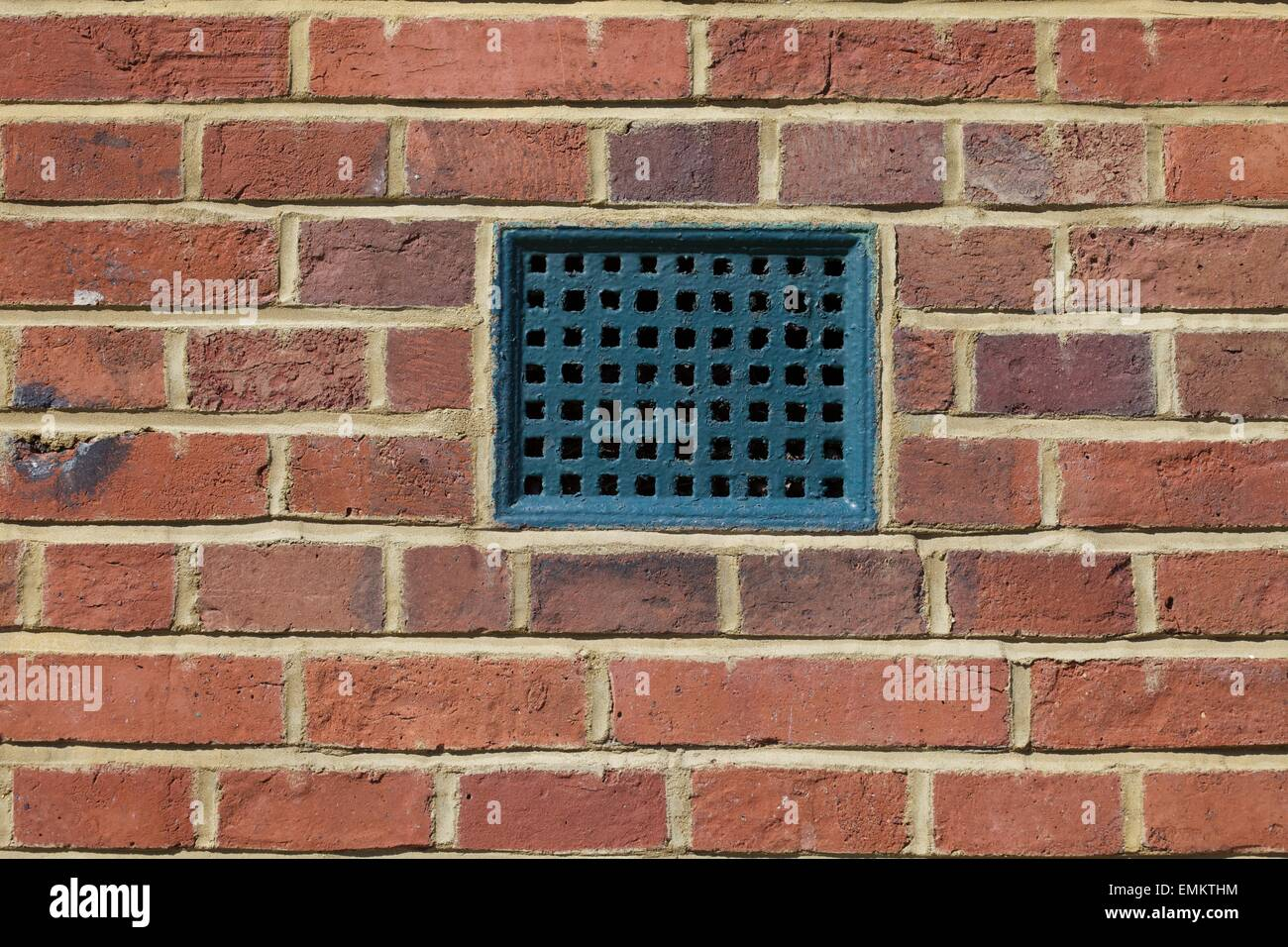 Close Up Shot Of Air Vent In Brick Wall Stock Photo