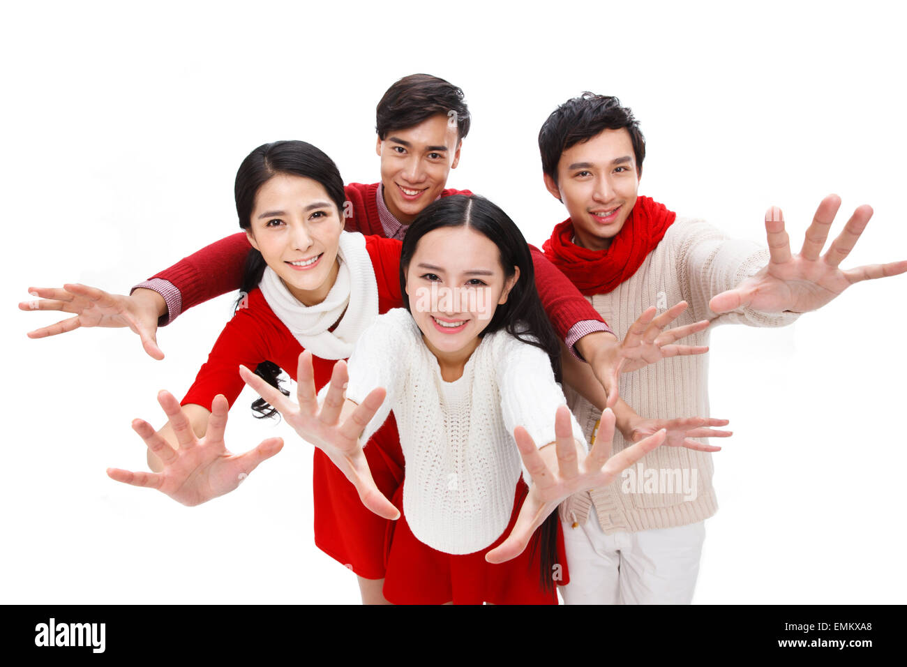 Young men and women fashion do grasping the hand gesture - Stock Image