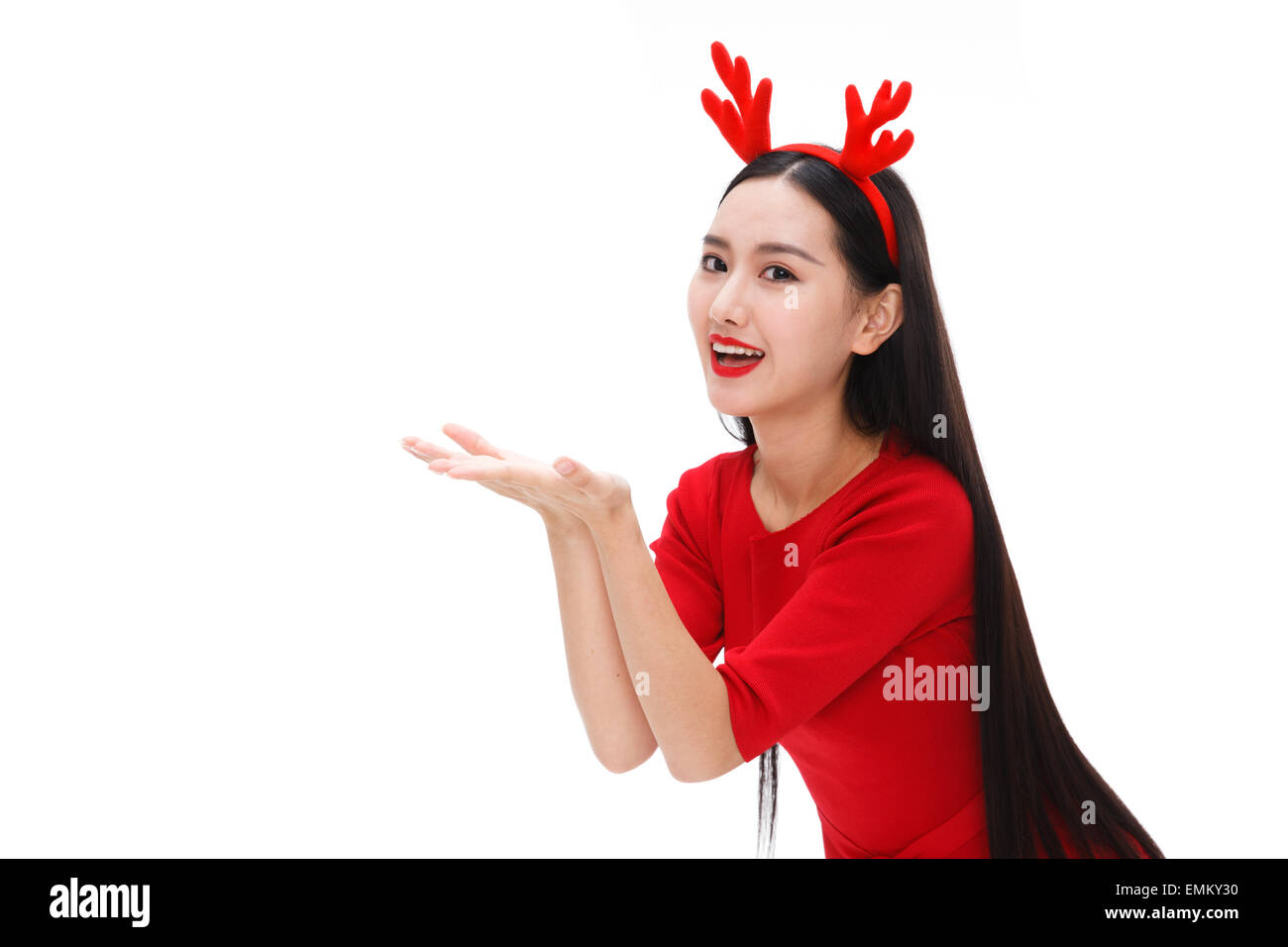 Wearing a headdress of young women do holding gesture - Stock Image