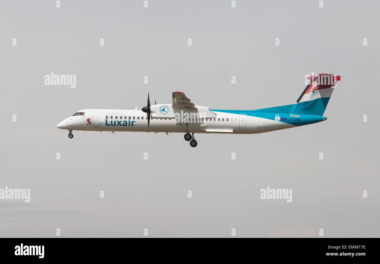 A Luxair Bombardier Dash 8 approaching to the El Prat Airport in Barcelona, Spain. - Stock Image