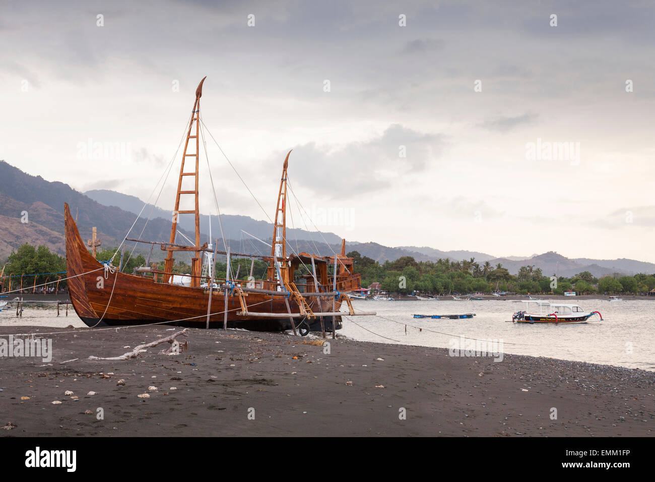 Replica merchant ship, traditional wooden boat on beach, Pemuteran, Bali, Indonesia - Stock Image
