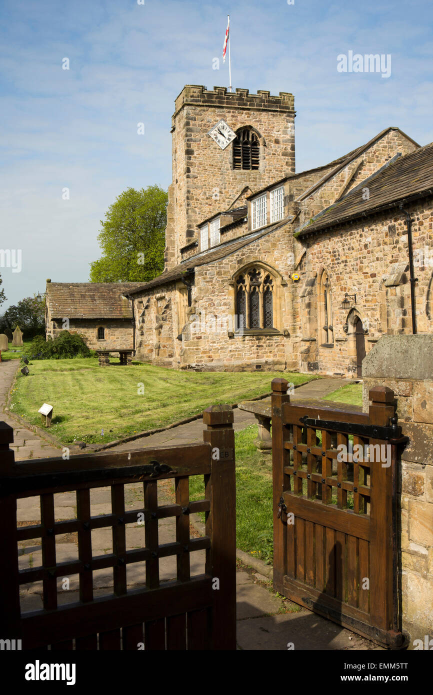UK, England, Lancashire, Ribble Valley, Ribchester, gate to Parish Church of St Wilfrid, with 1812 clock in tower - Stock Image