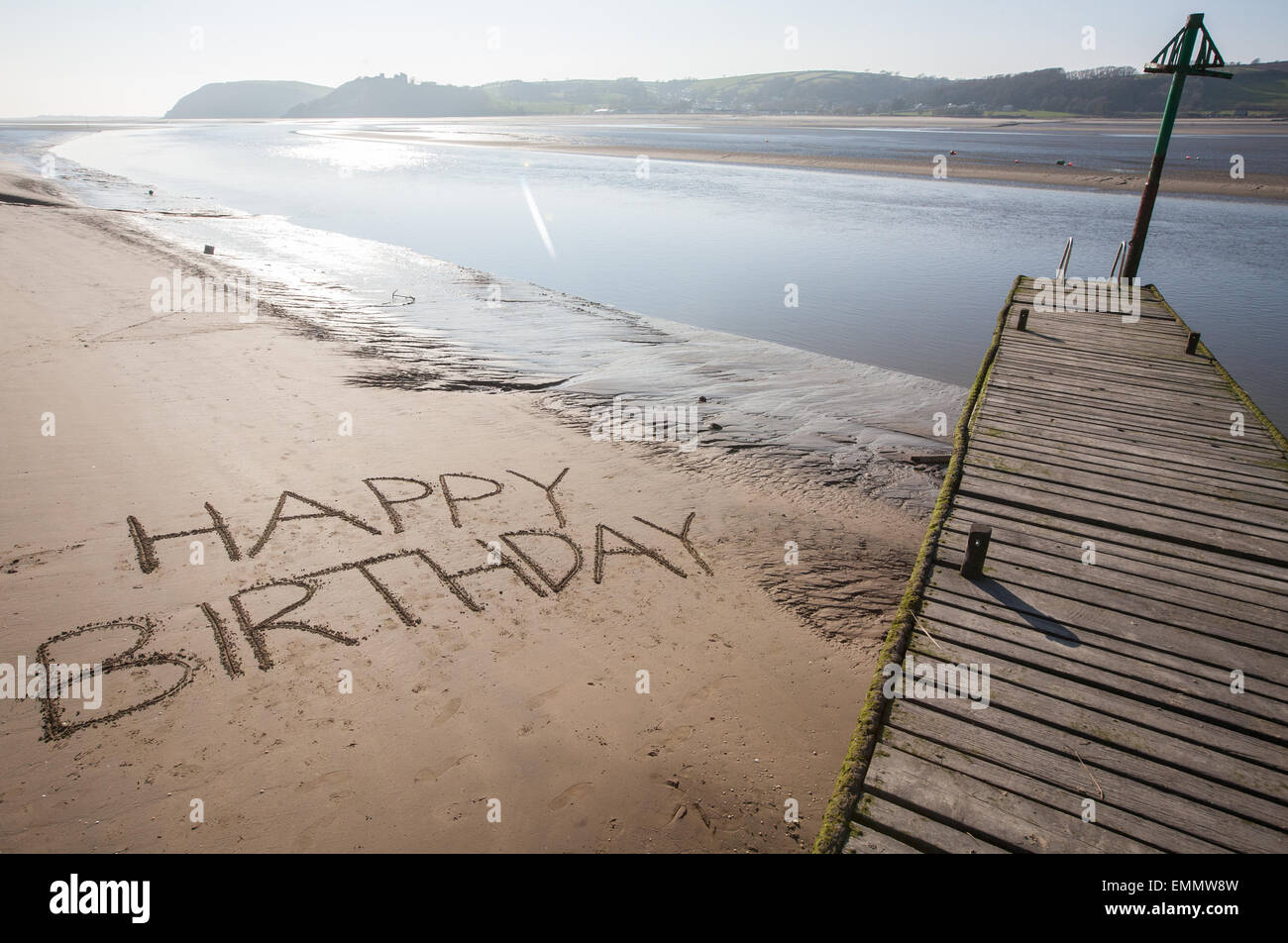 Happy Birthday Written In The Sands On Beach At Ferryside With Llanstephan BackgroundCarmarthenshireWest Wales