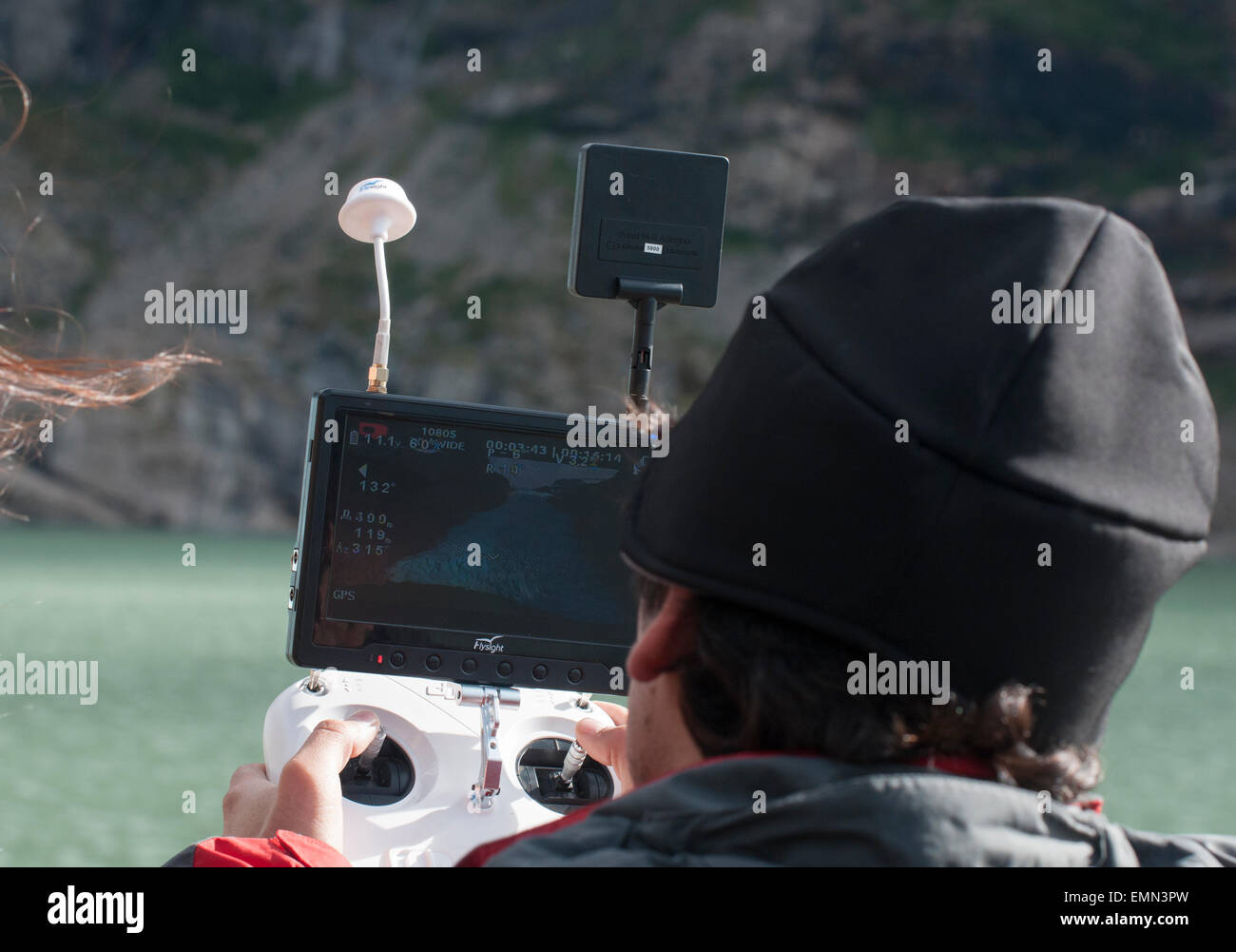 Man using a camera drone at Serrano Glacier in a Chilean national park - Stock Image