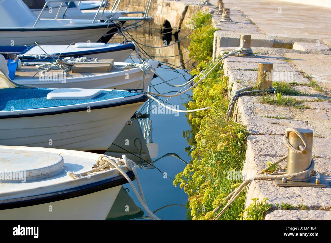 Boats tied at the marina - bow, ropes and mooring bollard view - Stock Image
