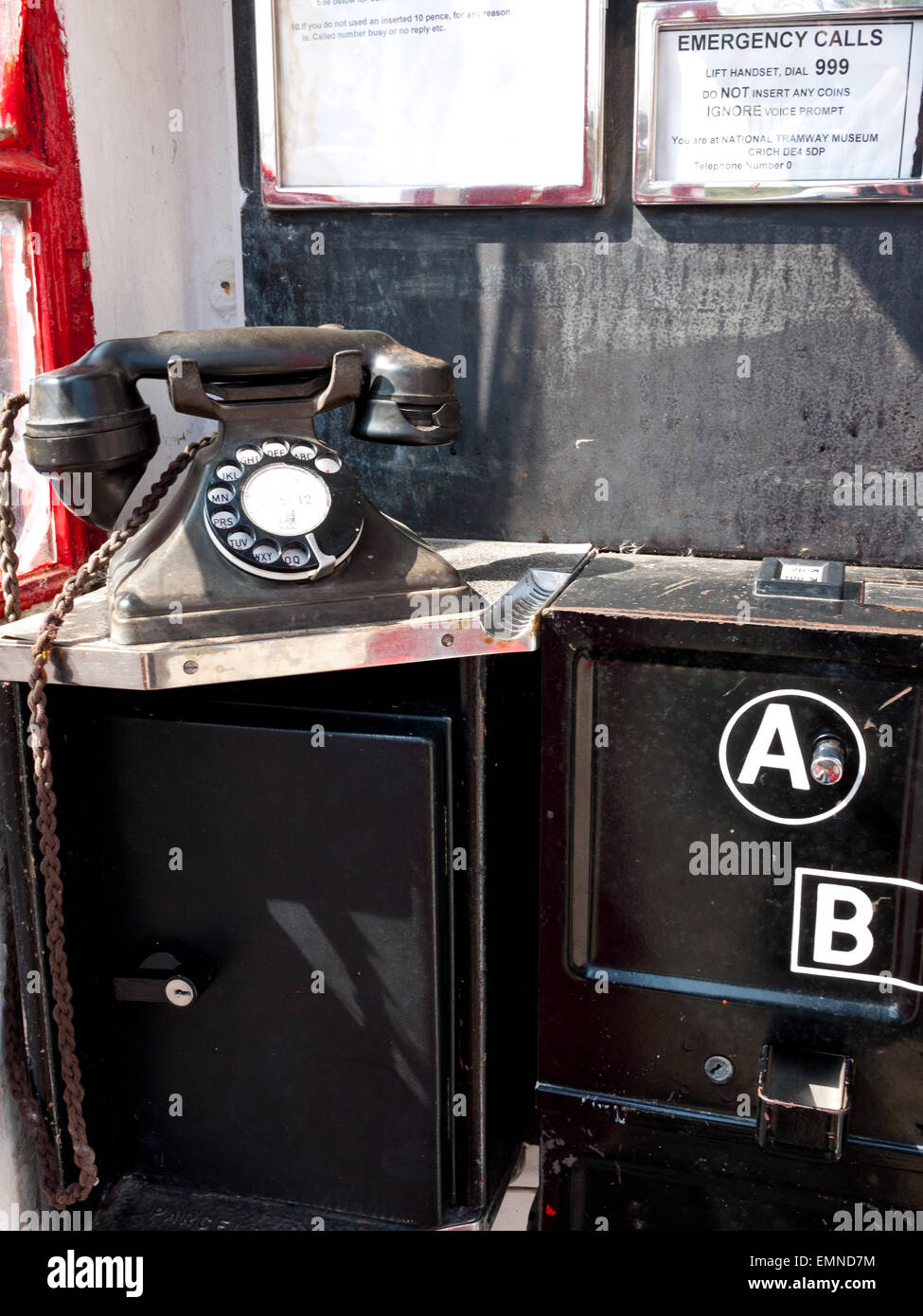 Vintage Telephone Box with old phone. England. UK. - Stock Image