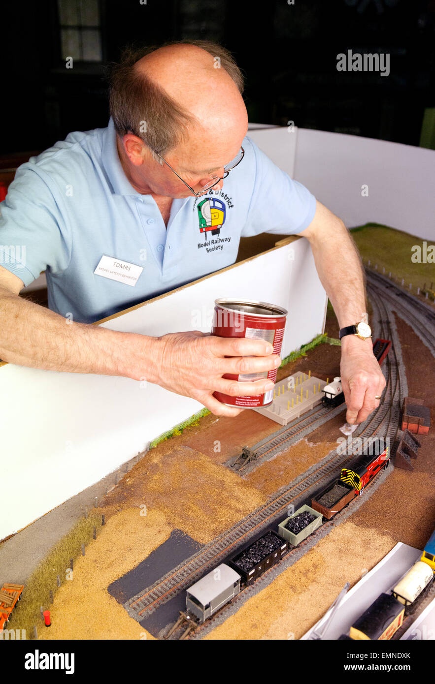 A model railway enthusiast building a track, Bressingham Steam Museum, Norfolk UK - Stock Image