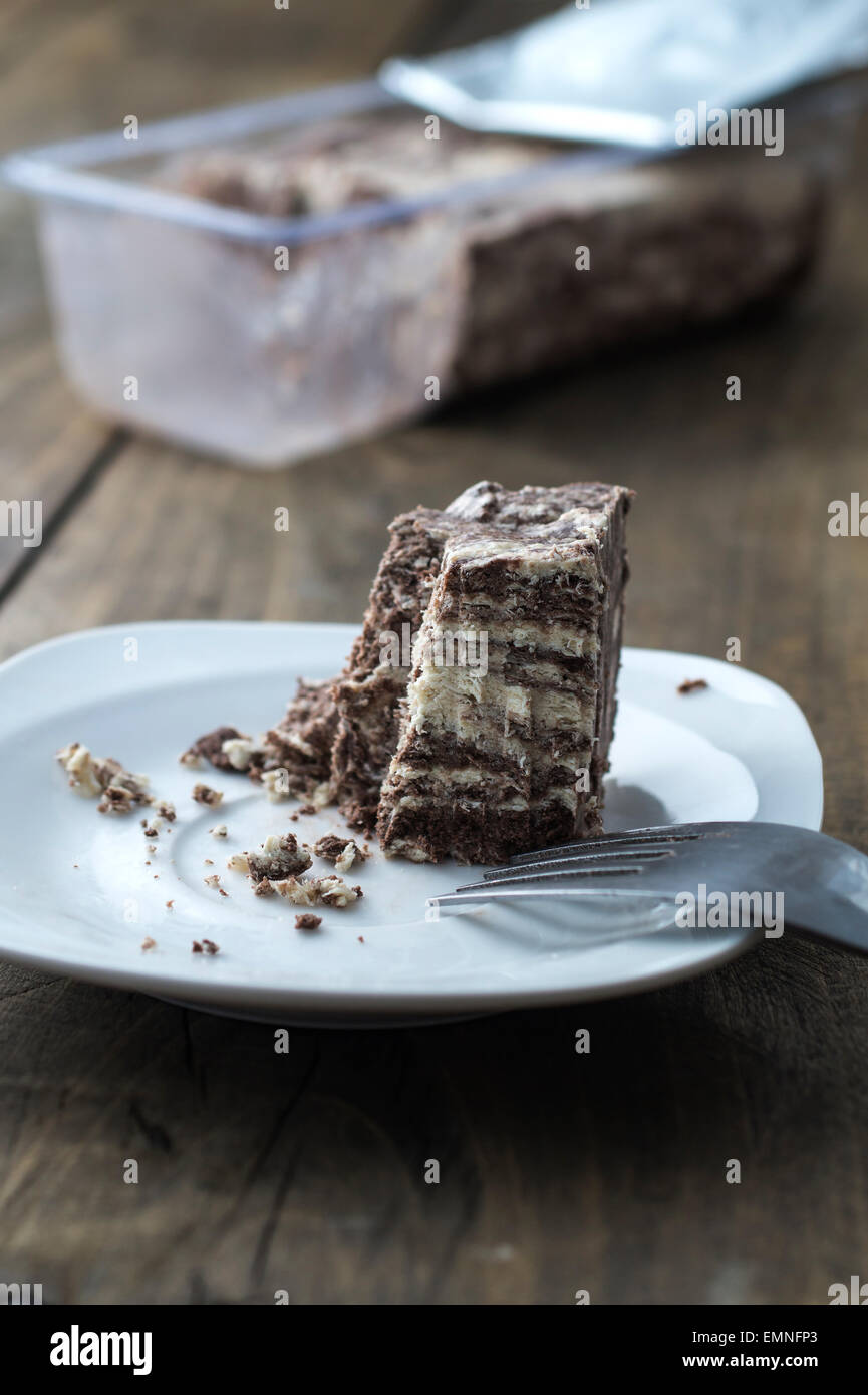 Halva with almonds and raisins on plate,  close up - Stock Image