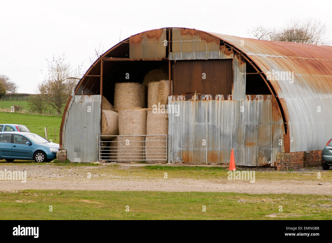 Anderson shelter air raid raids shelters temporary world war 2 two building building corrugated iron sheet sheets - Stock Image