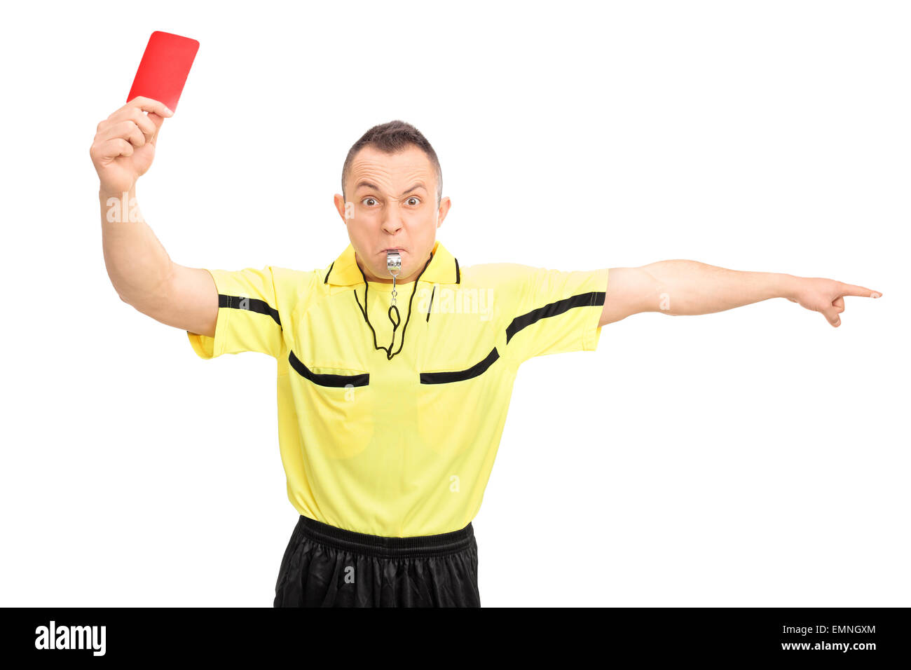 Angry football referee in a yellow jersey showing a red card and pointing with his hand isolated on white background - Stock Image