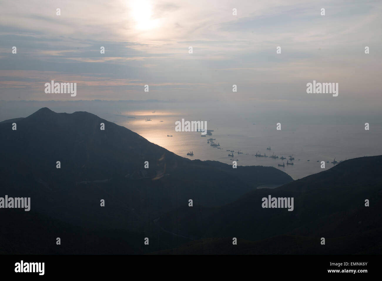 Sun rays and clouds seen from the Lantau island in Hong Kong - Stock Image