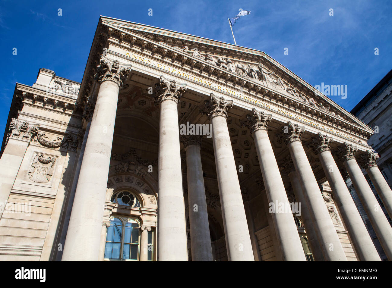 Looking up at the magnificent exterior of the Royal Exchange in the City of London. - Stock Image