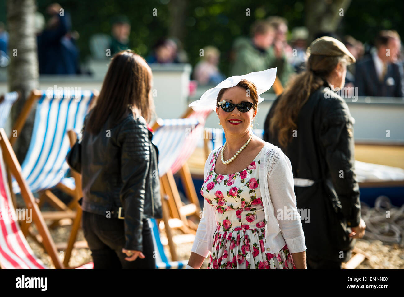 CHICHESTER, ENGLAND - September 12-14, 2014: Historic automobile racing festivities on and off the track for the Stock Photo