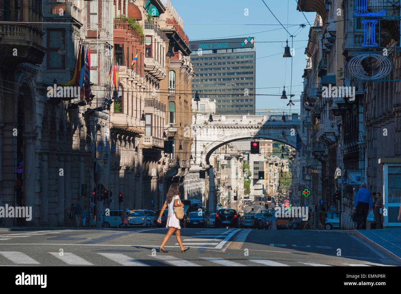 Genoa city street, a woman crosses the Via XX Settembre in the center of the city of Genoa, Liguria, Italy. - Stock Image
