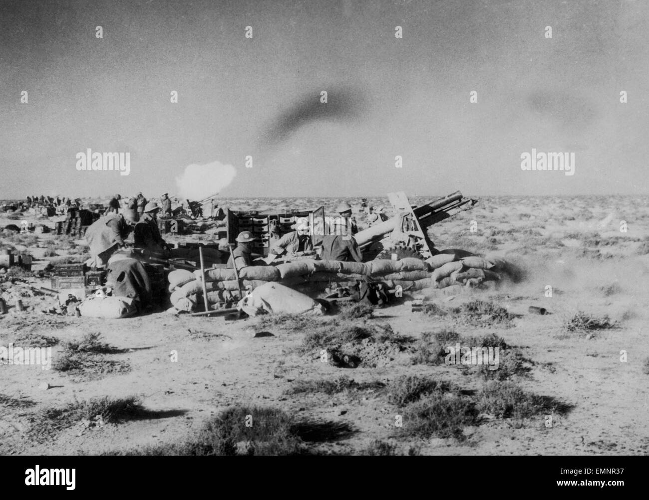 British artillery in action, bombarding Tobruk before the infantry and tanks attacked 20th January 1941 - Stock Image