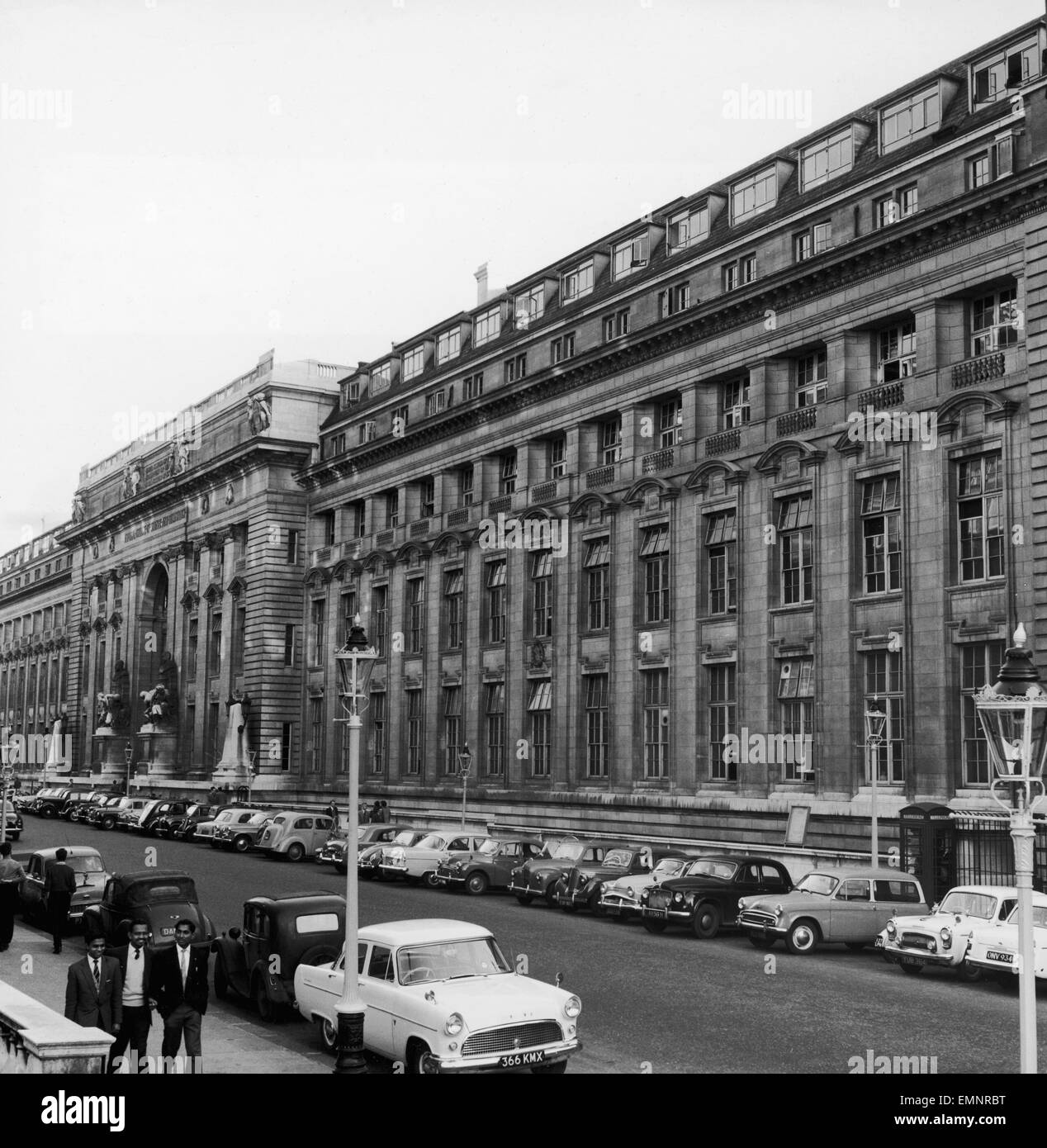 Cars parked outside the Imperial College of Science and technology in South Kensington, London. Circa 1960. - Stock Image