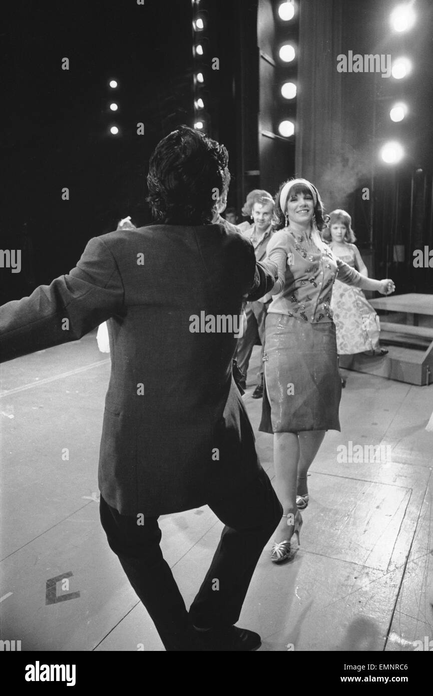 Members of the cast of Grease seen here on stage at the Coventry Theatre during a dress rehearsal. The musical show - Stock Image